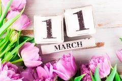 Blocos de madeira com data de dia das mães, o 11 de março Foto de Stock Royalty Free