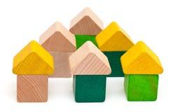 Blocos de madeira do brinquedo construídos em casas Fotografia de Stock Royalty Free