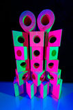 Blocos de madeira do brinquedo na luz colorida Foto de Stock Royalty Free