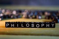 Blocos de madeira do conceito da FILOSOFIA na tabela fotos de stock royalty free