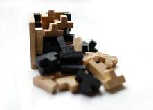 Blocos de madeira do enigma no fundo branco Fotografia de Stock Royalty Free