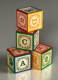 Blocos do alfabeto da criança empilhados Imagem de Stock