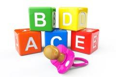 Blocos e pacifier alfabéticos Fotografia de Stock