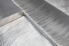 Blocos feitos à máquina do metal em um ângulo Fotografia de Stock