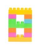 blocs colorés de plastique formant le numéro huit Photos libres de droits