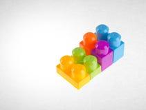 Blocs constitutifs ou blocs constitutifs en plastique sur le fond Images libres de droits