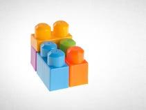 Blocs constitutifs ou blocs constitutifs en plastique sur le fond Photographie stock libre de droits