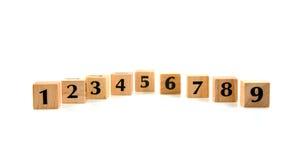 Blocs en bois de ligne avec des numéros Photographie stock libre de droits