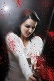 Blod katana Killer girl. Beauty danger katana Killer girl Stock Photo