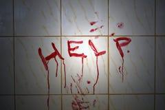 bloda ner hjälpinskriften arkivbild
