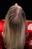 Blode Female Leaning Back. Rear view of blonde female leaning back Stock Image