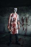 Blodig clown-galning med yxa Fotografering för Bildbyråer