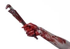 Blodig hand som rymmer en justerbar skiftnyckel, blodig tangent, galen rörmokare, blodigt tema, halloween tema, vit bakgrund som  Royaltyfri Fotografi
