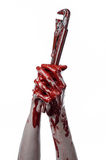 Blodig hand som rymmer en justerbar skiftnyckel, blodig tangent, galen rörmokare, blodigt tema, halloween tema, vit bakgrund som  Fotografering för Bildbyråer