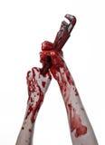 Blodig hand som rymmer en justerbar skiftnyckel, blodig tangent, galen rörmokare, blodigt tema, halloween tema, vit bakgrund som  Royaltyfria Bilder
