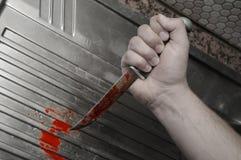 blodig handkniv royaltyfria bilder
