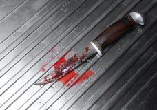 blodig kniv Arkivfoto