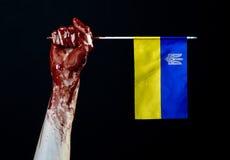 Blodiga händer, flaggan av Ukraina i blodet, revolution i Ukraina, svart bakgrund Royaltyfria Bilder