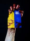 Blodiga händer, flaggan av Ukraina i blodet, revolution i Ukraina, svart bakgrund Arkivbild