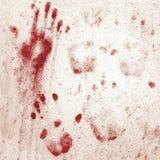 Blodiga handprints på väggen Arkivfoton