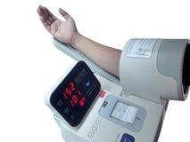 Blodtryckbildskärm för vård- kontroll arkivfoto