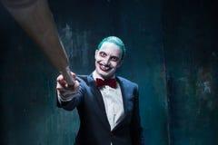 Bloedig Halloween-thema: gek jokergezicht royalty-vrije stock foto's
