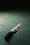 Bloedig mes stock afbeelding