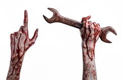 Bloedige hand die een grote moersleutel, bloedige moersleutel, groot zeer belangrijk, bloedig thema, Halloween-thema, gekke mecha Royalty-vrije Stock Afbeelding