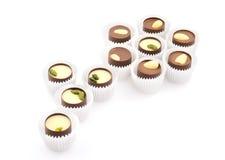 Bloem die uit chocoladesnoepjes in omslagen wordt samengesteld Royalty-vrije Stock Foto's