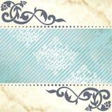 Bloemen arabesqueachtergrond in blauw en gouden Stock Afbeeldingen