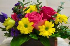 Bloemen in de borst stock afbeelding