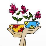 Bloemen in de kop Stock Afbeelding