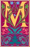 Bloemen decoratieve brief M in Kleur Stock Fotografie