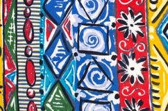 Bloemen en vormen op kleurrijke stof Stock Afbeelding
