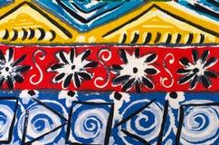 Bloemen en vormen op kleurrijke stof Royalty-vrije Stock Afbeeldingen