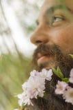 Bloemen Gebaarde Mens stock foto