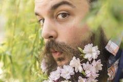 Bloemen Gebaarde Mens stock afbeeldingen