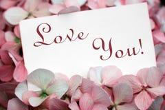 Bloemen met liefdekaart Stock Afbeelding