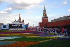 Bloemen op het Rode Vierkant Stock Afbeeldingen