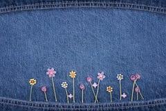 Bloemen op jeans Royalty-vrije Stock Fotografie