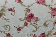 Bloemenbehang als achtergrond op de muur Stock Foto's
