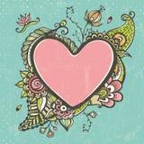 Bloemenkrabbelkader in de vorm van hart Royalty-vrije Stock Foto's
