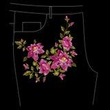 Bloemenpatroon van borduurwerk het kleurrijke jeans met hondrozen Royalty-vrije Stock Afbeeldingen