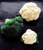 Bloemkolen en broccoli Stock Foto's