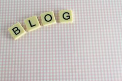 Blog. The word 'blog' against a background pattern of pink checks Stock Photos