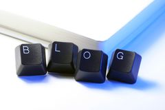 Blog. Written with keyboard keys in front of a notebook Royalty Free Stock Photography