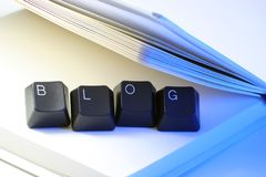 Blog. Written with keyboard keys between a notebook Royalty Free Stock Photo