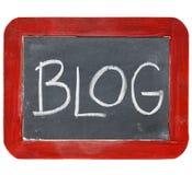Blog blackboard sign. Blog sign - white chalk handwriting on old slate blackboard with grunge red wood frame Royalty Free Stock Images