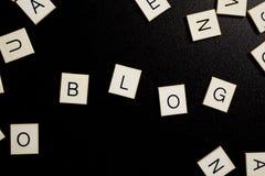 Blog - brief op zwarte achtergrond Stock Foto
