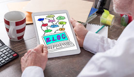Blog concept on a tablet. Blog concept shown on a tablet held by a man Stock Image